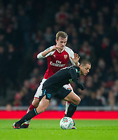 West Ham's Chicharito and Arsenal's Rob Holding during the Carabao Cup QF match between Arsenal and West Ham United at the Emirates Stadium, London, England on 19 December 2017. Photo by Andrew Aleksiejczuk / PRiME Media Images.