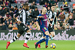 Andres Iniesta Lujan (C) of FC Barcelona fights for the ball with Cheik Doukoure (L) and David Remeseiro Salgueiro, Jason, of Levante UD during the La Liga 2017-18 match between FC Barcelona and Levante UD at Camp Nou on 07 January 2018 in Barcelona, Spain. Photo by Vicens Gimenez / Power Sport Images