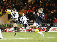 Lawrence Shankland shoots past Paul Watson in the St Mirren v Falkirk Scottish Professional Football League Ladbrokes Championship match played at the Paisley 2021 Stadium, Paisley on 1.3.16.