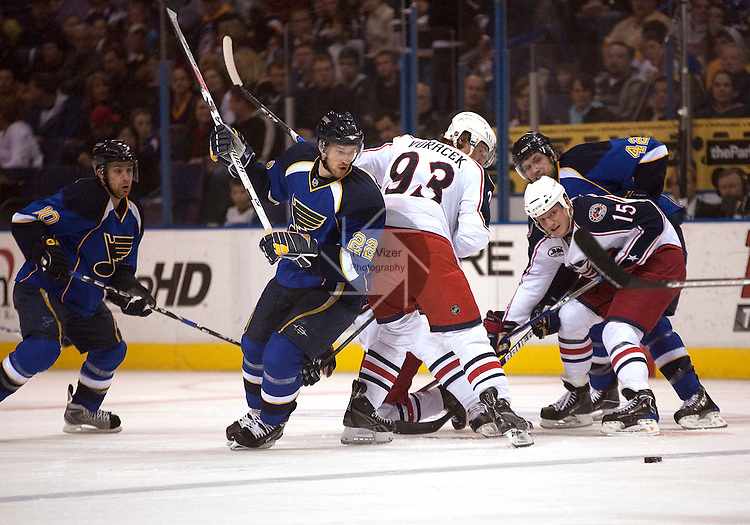 April 10 2009       From left:  Blues player Andy McDonald (10), Blues player Brad Boyes (22), Blue Jackets player Jakub Voracek (93), Blue Jackets player Derek Dorsett (15), and Blues player David Backes (42) involved in a puck drop turn to see the puck skate away down the ice in the second period.   The St. Louis Blues hosted the Columbus Blue Jackets in the final regular season home game for the Blues at the Scottrade Center in downtown St. Louis, MO. ..            *******EDITORIAL USE ONLY*******