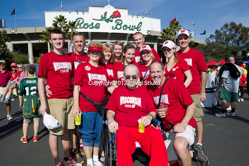 Wisconsin Badgers fans, the Mutch Family, celebrate their 50th wedding anniversary with their family at the 2012 Rose Bowl NCAA football game against the Oregon Ducks in Pasadena, California on January 2, 2012. The Ducks won 45-38. (Photo by David Stluka)