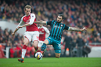 Southampton's Charlie Austin and Arsenal's Rob Holding during the EPL - Premier League match between Arsenal and Southampton at the Emirates Stadium, London, England on 8 April 2018. Photo by Andrew Aleksiejczuk / PRiME Media Images.