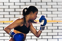 Geraldin Hamann, a young Colombian boxer, practices punching while training in the boxing gym in Cali, Colombia, 26 June 2013. During the recent years, Kina Malpartida, a Peruvian female professional boxer, has won the World Championship title several times and so she has become a sporting idol and an inspiration for a generation of young girls throughout Latin America. Working out hard in poorly equipped gyms, they dream of becoming a boxing star. The Cauca Valley and the Caribbean coast are believed to be a home of the most talented female boxers in Colombia.