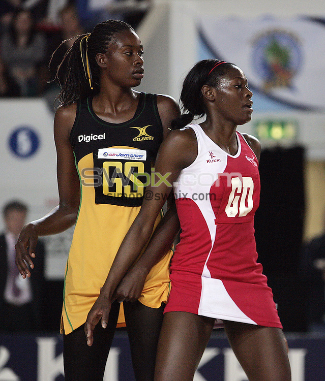 PICTURE BY VAUGHN RIDLEY/SWPIX.COM - Netball - The Co-Operative International Series - England v Jamaica, Second Test - Skydome Arena, Coventry, England - 24/02/09...Copyright - Simon Wilkinson - 07811267706...England's Sonia Mkoloma and Jamaica's Romelda Aiken.