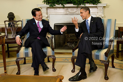 Washington, DC - February 24, 2009 -- United States President Barack Obama, right, meets with the Japanese Prime Minister Taro Aso in the Oval Office, Tuesday, February 24, 2009 to discuss the close and longstanding alliance between the United States and Japan.  Also, the meeting emphasizes the importance of consultation between leaders of the world's largest economies in the run-up to the London Economic Summit..Credit: Ken Cedeno - Pool via CNP