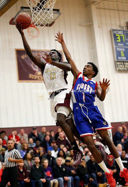 Waterbury, CT- 15 January 2016-011516CM11-  Sacred Heart's Raheem Solomon glides to the hoop against  Crosby's Roary Jadusingh during their NVL matchup in Waterbury on Friday.  Sacred Heart would go onto win, 96-61.  Christopher Massa Republican-American