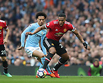 Luis Antonio Valencia of Manchester United and Leroy Sane of Manchester City during the premier league match at the Etihad Stadium, Manchester. Picture date 7th April 2018. Picture credit should read: Simon Bellis/Sportimage