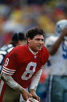 SAN FRANCISCO, CA:  Quarterback Steve Young of the San Francisco 49ers smiles on the field without his helmet during the NFC Championship game against the Dallas Cowboys at Candlestick Park in San Francisco, California on January 17, 1993. (Photo by Brad Mangin)