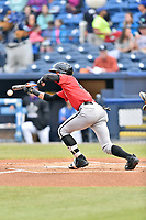 Kannapolis Intimidators center fielder Joel Booker (23) lays down a bunt during a game against the Asheville Tourists at McCormick Field on April 18, 2017 in Asheville, North Carolina. The Intimidators defeated the Tourists 6-1. (Tony Farlow/Four Seam Images)