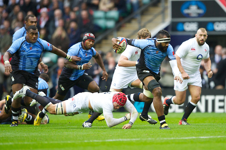 Api Naikatini of the Flying Fijians charges through the tackle of Tom Johnson of England during the QBE International between England and Fiji at Twickenham on Saturday 10th November 2012 (Photo by Rob Munro)