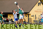 Liam O'Brien, Finuge in action against Donal O'Neill and Garreth Prenderville, Keel in the 2020 Kerry Petroleum Junior Premier Club Championship at Connolly park, Tralee, on Sunday.