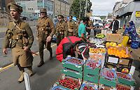 Men in World War I gear on St Helen's Road, Swansea, south Wales UK. Friday 01 July 2016
