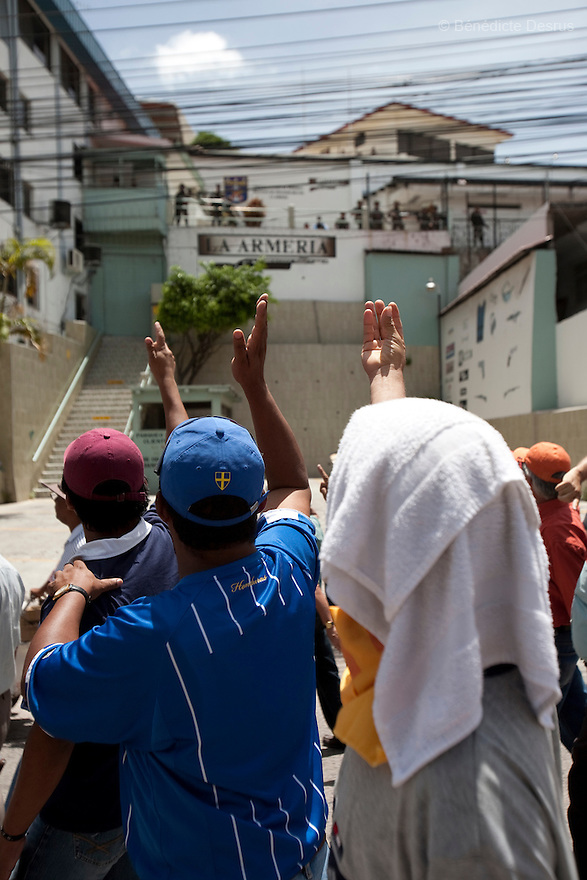 4 July 2009 - Tegucigalpa, Honduras  Thousands of supporters of ousted Honduran President Manuel Zelaya march towards the international airport in Tegucigalpa, capital of Honduras. Zelaya has been forced into exile after being arrested by a group of soldiers in an apparent military coup. Zelaya was warned he would be arrested if he return to Honduras but has vowed to return to Honduras on Sunday accompanied by Latin American leaders. Photo credit: Benedicte Desrus