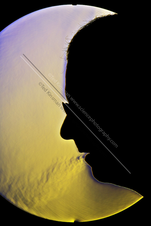A schlieren image of a a man breathing through his mouth.  The schlieren images identifies areas of different temperature by using the change in the index of refraction of a fluid due to a change in temperature.