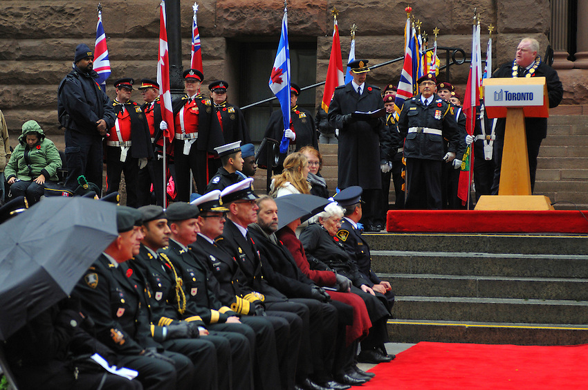 November 11, 2013, surrounded by dignitaries, amidst Torontonians of all stripes, Mayor Rob Ford delivers a commemorative speech on the steps of Toronto's Old City Hall, during Remembrance Day Ceremonies at Toronto, Ontario, Canada.
