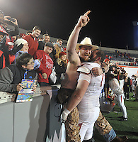 NWA Democrat-Gazette/MICHAEL WOODS • @NWAMICHAELW<br /> University of Arkansas lineman Arkansas offensive lineman Dan Skipper (70) gets a congratulatory hug from his brother Matt Skipper following the Razorbacks 45-23 win over Kansas State in the 57th annual AutoZone Liberty Bowl January 2, 2016.
