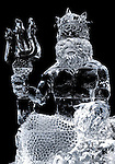 Sculpture of Neptune made of ice illuminated in darkness Isolated silhouete on black background Toronto IceFest 2008