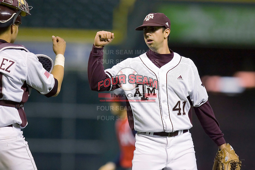 Travis Starling #41 of the Texas A&M Aggies is congratulated by Kevin Gonzalez #10 after closing out the game versus the Houston Cougars in the 2009 Houston College Classic at Minute Maid Park March 1, 2009 in Houston, TX.  The Aggies defeated the Cougars 5-3. (Photo by Brian Westerholt / Four Seam Images)