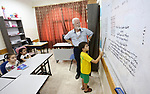 Samaritan tutor Ragheb Mfarrej ,78, teaches kids the ancient Samaritan language, at Mount Gerizim near the West Bank city of Nablus, on October 7, 2018. The kids start learning Hebrew ancient language on their 6 years old, daily for a full round year. Today the ancient hebrew used by the samaritens in prayers, wedding, parties and circumcision. every samaritans males and females should learn this languge at 6 years, so he she can joine the real samaritan life. Photo by Shadi Jarar'ah