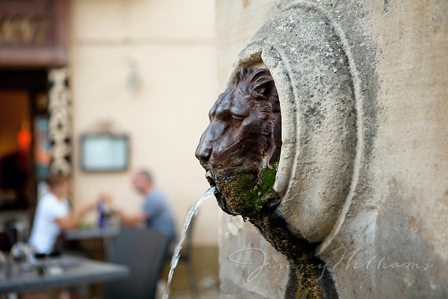 A lion's head fountain sculpute in Lourmarin, Provence, France