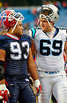 Carolina Panthers tackle Jordan Gross (69) has some pre-game words with defensive tackle Lauvale Sape (93) prior to facing the Buffalo Bills on November 27, 2005 at Ralph Wilson Stadium in Orchard Park, NY. The Panthers defeated the Bills 13-9. Mandatory Photo Credit: Ed Wolfstein