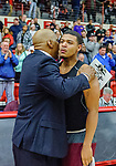 WEST HARTFORD, CT. 15 March 2018-031518BS43 - A coach consoles George Gamble (33) from Windsor after getting beat in the Div I semi-finals between Sacred Heart vs Windsor at the University of Hartford on Thursday evening. Sacred Heart won in a thriller 59-58 over Windsor and advances to the finals at Mohegan Sun. Bill Shettle Republican-American