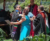 Omar Rodriguez hugs his parents, Mercedes A. Rodriguez and Justo Rodriguez, who both work at Oxy. Occidental College Commencement on Sunday, May 18, 2014 at the Remsen Bird Hillside Theater. (Photo by Marc Campos, Occidental College Photographer)