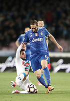 Calcio, Serie A: Napoli, stadio San Paolo, 2 aprile, 2017.<br /> Juventus Gonzalo Higuain (r) in action with Napoli's Dries Mertens (l) during the Italian Serie A football match between Napoli and Juventus at San Paolo stadium, April 2, 2017<br /> UPDATE IMAGES PRESS/Isabella Bonotto