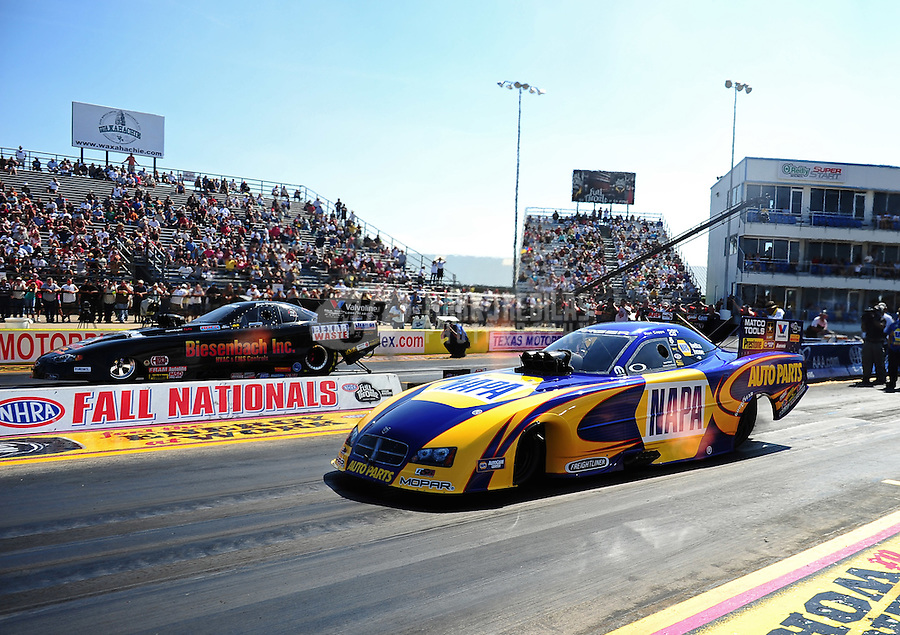 Sept. 25, 2011; Ennis, TX, USA: NHRA funny car driver Ron Capps (near lane) racing alongside brother Jon Capps during the Fall Nationals at the Texas Motorplex. Mandatory Credit: Mark J. Rebilas-