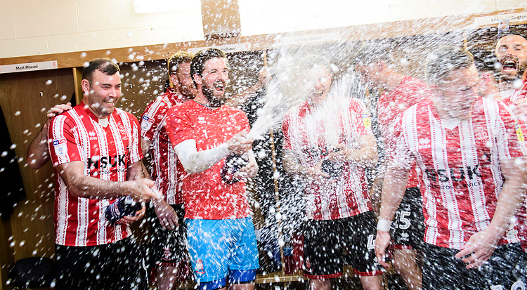 Lincoln City's Matt Rhead, left, and Lincoln City's Josh Vickers celebrate in the changing room after winning the league<br /> <br /> Photographer Chris Vaughan/CameraSport<br /> <br /> The EFL Sky Bet League Two - Lincoln City v Tranmere Rovers - Monday 22nd April 2019 - Sincil Bank - Lincoln<br /> <br /> World Copyright © 2019 CameraSport. All rights reserved. 43 Linden Ave. Countesthorpe. Leicester. England. LE8 5PG - Tel: +44 (0) 116 277 4147 - admin@camerasport.com - www.camerasport.com