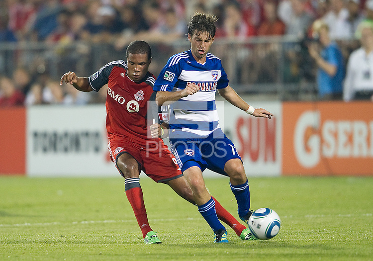 FC Dallas midfielder Ricardo Villar #11 and Toronto FC forward Ryan Johnson #9 in action during an MLS game between the FC Dallas and the Toronto FC at BMO Field in Toronto on July 20, 2011..FC Dallas won 1-0.