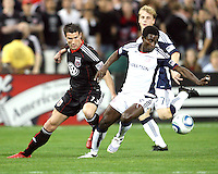 Chris Pontius #13 of D.C. United loses the ball to Emmanuel Osei #5 of the New England Revolution during an MLS match on April 3 2010, at RFK Stadium in Washington D.C.