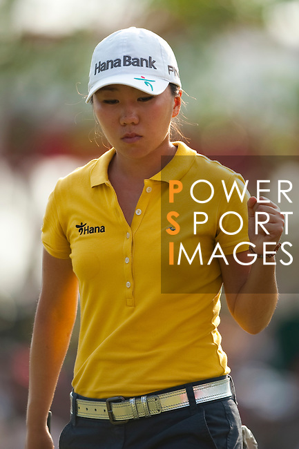 CHON BURI, THAILAND - FEBRUARY 19:  In Kyung Kim of South Korea celebrates to her putt on the 18th green during day three of the LPGA Thailand at Siam Country Club on February 19, 2011 in Chon Buri, Thailand. Photo by Victor Fraile / The Power of Sport Images