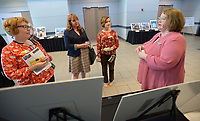 NWA Democrat-Gazette/ANDY SHUPE<br /> Kelly Colebar (from right), community resources administrator for the city of Fayetteville Community Resources Division, speaks Wednesday, March 21, 2018, about the city's Hearth Program with Andrea Newby, Rachel Reynolds and Erika Wilhite, all representatives of Artist's Laboratory Theatre, during a Community Development Block Grant fair at the Fayetteville Town Center. The Hearth Program offers housing assistance and is one of several city-sponsored programs that were explained at the fair.