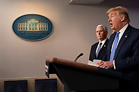 United States President Donald J. Trump makes a statement on coronavirus during a news briefing at the White House in Washington, DC on Sunday, March 15, 2020.  US Vice President Mike Pence looks on at left.<br /> Credit: Chris Kleponis / Pool via CNP/AdMedia