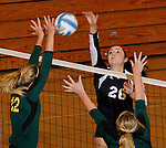 SPEARFISH, SD - NOVEMBER 1, 2013:  Kaylee Pierce #26 of Colorado Christian hits toward blockers Meghan Sipe #12 and Shelby Mayer #13 of Black Hills State during their game at the Donald E. Young Center in Spearfish, S.D. (Photo by Dick Carlson/Inertia)