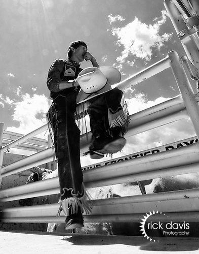 A young Professional Rodeo Association Cowboy watches and contemplates his upcoming bull ride during the annual Cheyenne Frontier Days Rodeo in Cheyenne, Wyoming.