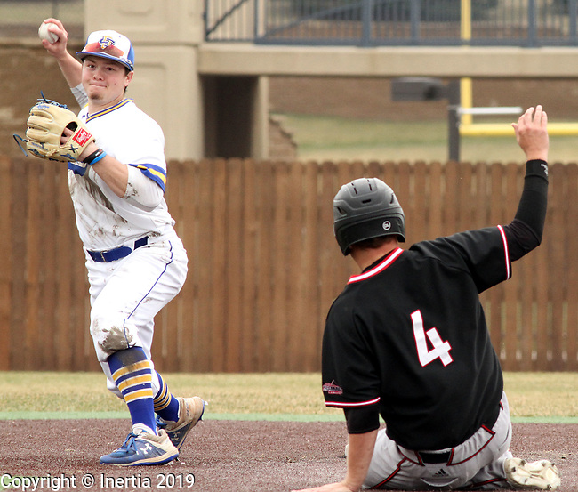 SIOUX FALLS, SD - APRIL 6: Braeden Brown from South Dakota State looks to turn a double play as Parker Smejkal from Nebraska Omaha slides into second Saturday afternoon in Sioux Falls.  (Photo by Dave Eggen/Inertia)