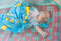 Thailand, Mae Hong Son. Baby from Lahu tribe in northern Thailand.