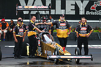 Jun 19, 2015; Bristol, TN, USA; NHRA top fuel driver Leah Pritchett with crew members during qualifying for the Thunder Valley Nationals at Bristol Dragway. Mandatory Credit: Mark J. Rebilas-