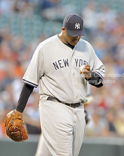 Baltimore, MD - September 2, 2009 -- New York Yankees C.C. Sabathia (52) inspects the ball as he prepares to pitch in the first inning against the Baltimore Orioles at Oriole Park at Camden Yards in Baltimore, MD on Wednesday, September 2, 2009..Credit: Ron Sachs / CNP.(RESTRICTION: NO New York or New Jersey Newspapers or newspapers within a 75 mile radius of New York City)