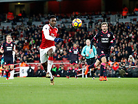 Danny Welbeck of Arsenal chases the ball during the Premier League match between Arsenal and Huddersfield Town at the Emirates Stadium, London, England on 29 November 2017. Photo by Carlton Myrie / PRiME Media Images.