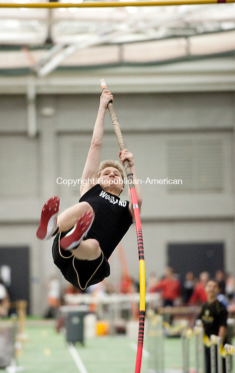 NEW HAVEN, CT-012014JS08-Woodland's Drew Chura competes in the pole vault during the NVL indoor boys and girls track championships Tuesday at the Floyd Little Athletic Center at Hillhouse High School in New Haven.<br /> Jim Shannon Republican-American