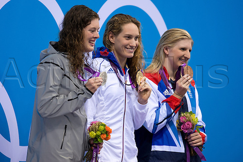 29.07.2012. London, England. Silver medallist Allison Schmitt (USA), Gold Medallist Camille Muffat (FRA) and Bronze Medallist Rebecca Adlington (GBR) stand on the podium for the Womens 400m Freestyle Final during the Swimming on Day 2 of the London 2012 Olympic Games at the Aquatics Centre on the Olympic Park.