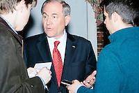 Former Virginia governor and Republican presidential candidate Jim Gilmore speaks with Daily Caller reporter Alex Pfeiffer (left) and senior editor Jamie Weinstein (in blue) at the Gilmore primary watch party at Fratello's in Manchester, New Hampshire, on the day of primary voting, Feb. 9, 2016. Gilmore finished in last place among major Republican candidates still in the race with a total of 150 votes.