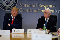 United States President Donald J. Trump listens during a teleconference with governors at the Federal Emergency Management Agency headquarters, Thursday, March 19, 2020, in Washington, DC. US Vice President Mike Pence is at right.<br /> Credit: Evan Vucci / Pool via CNP/AdMedia