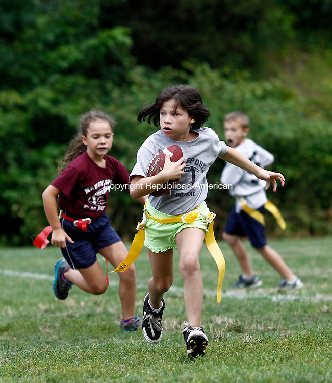 Naugatuck, CT- 29 July 2014-072914CM01- Ciara Spears carries the ball for team Gray during a Naugatuck youth flag football league game at Linden Park in Naugatuck on Tuesday.     Christopher Massa Republican-American