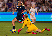 5th March 2020, Orlando, Florida, USA;  the United States midfielder Lindsey Horan (9) is challenged by England goalkeeper Carley Telford (1) during the Women's SheBelieves Cup soccer match between the USA and England on March 5, 2020 at Exploria Stadium in Orlando, FL.