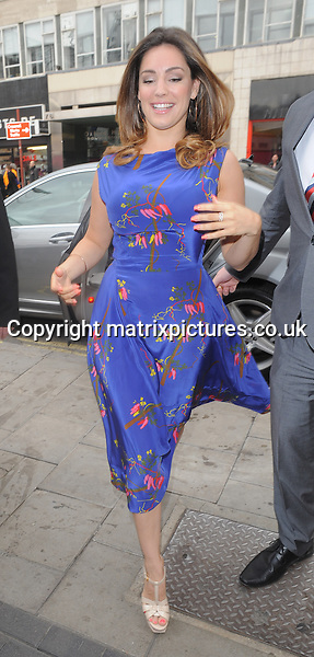 NON EXCLUSIVE PICTURE: PALACE LEE / MATRIXPICTURES.CO.UK<br /> PLEASE CREDIT ALL USES<br /> <br /> WORLD RIGHTS<br /> <br /> English model, actress and television presenter Kelly Brook is pictured arriving at the launch of her new fragrance, Audition, at The Perfume Shop on London's Oxford Street.<br /> <br /> Kelly looks chic and elegant in her blue silk floral dress as she arrives at the launch.<br /> <br /> MARCH 17th 2014<br /> <br /> REF: LTN 141359