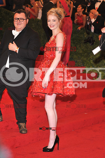 Emma Stone at the 'Schiaparelli And Prada: Impossible Conversations' Costume Institute Gala at the Metropolitan Museum of Art on May 7, 2012 in New York City. ©mpi03/MediaPunch Inc.